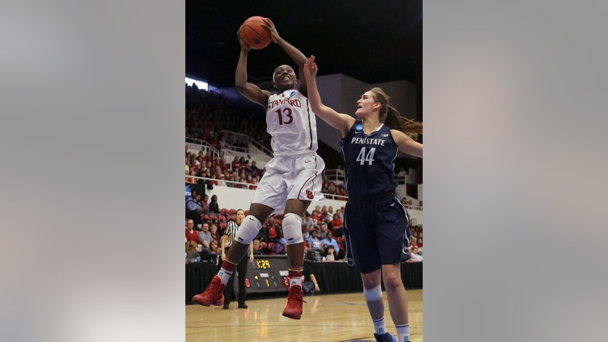 Stanford forward Chiney Ogwumike (13) shoots against Penn State forward/center Tori Waldner (44) during the first half of a regional semifinal game at the NCAA college basketball tournament in Stanford , Calif., Sunday, March 30, 2014. (AP Photo/Jeff Chiu)