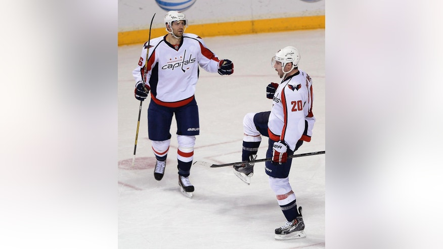 Washington Capitals right wing Troy Brouwer (20) celebrates with Eric Fehr (16) after scoring a goal in the second period of an NHL hockey game against the Nashville Predators on Sunday, March 30, 2014, in Nashville, Tenn.  (AP Photo/Mark Zaleski)