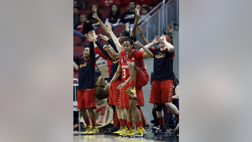 Maryland guard Shatori Walker-Kimbrough (32) and the bench reacts after a 3-point basket during the first half of a regional semifinal game against Tennessee at the NCAA college basketball tournament on Sunday, March 30, 2014, in Louisville, Ky. (AP Photo/John Bazemore)