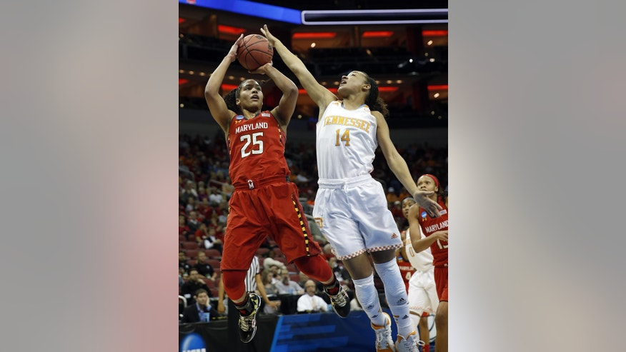 Maryland forward Alyssa Thomas (25) goes up to shoot against Tennessee guard Andraya Carter (14) during the first half of a regional semifinal game at the NCAA college basketball tournament on Sunday, March 30, 2014, in Louisville, Ky. (AP Photo/John Bazemore)