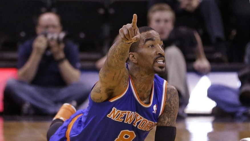 New York Knicks' J.R. Smith (8) points up court after the ball goes out of bounds in the first quarter during an NBA basketball game against the Utah Jazz Monday, March 31, 2014, in Salt Lake City. (AP Photo/Rick Bowmer)