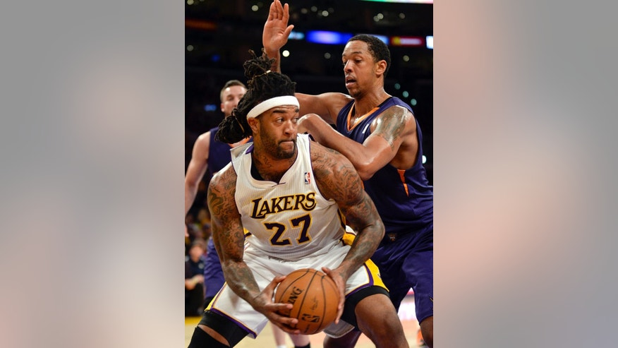 Los Angeles Lakers forward Jordan Hill (27) battles Phoenix Suns forward Channing Frye, back right, in the first half of an NBA basketball game, Sunday, March 30, 2014, in Los Angeles.(AP Photo/Gus Ruelas)