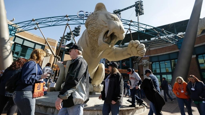 Baseball fans arrive for a baseball game between the Detroit Tigers and the Kansas City Royals at Comerica Park in Detroit, Monday, March 31, 2014. (AP Photo/Carlos Osorio)