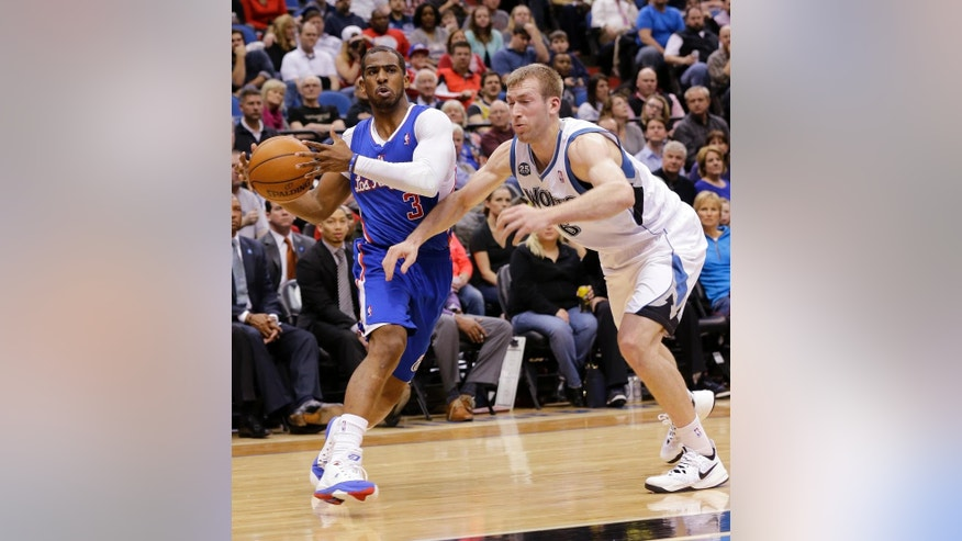 Los Angeles Clippers guard Chris Paul (3) drives against Minnesota Timberwolves forward Robbie Hummel (6) during the second quarter of an NBA basketball game in Minneapolis, Monday, March 31, 2014.  (AP Photo/Ann Heisenfelt)