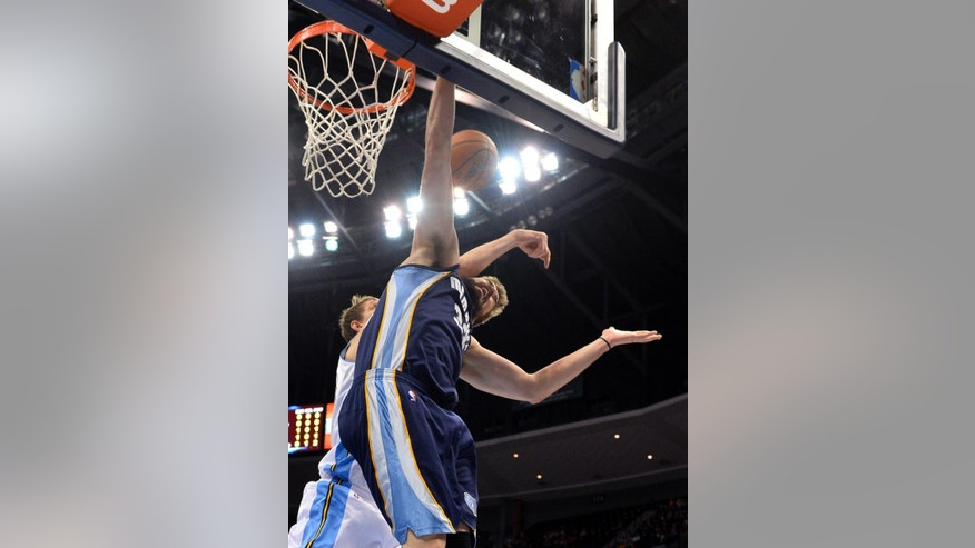 Denver Nuggets center Timofey Mozgov (25) from Russia fouls Memphis Grizzlies center Marc Gasol (33) from Spain during the second quarter of an NBA basketball game on Monday, March 31, 2014, in Denver. (AP Photo/Jack Dempsey)