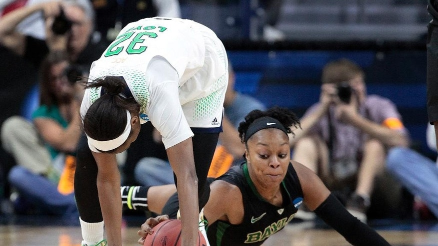 Baylor guard Odyssey Sims scrambles with Notre Dame guard Jewell Loyd (32) for a loose ball in the first half of their NCAA women's college basketball tournament regional final game at the Purcell Pavilion in South Bend, Ind., Monday, March 31, 2014. (AP Photo/Paul Sancya)