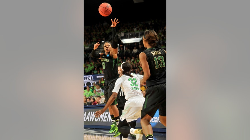 Baylor guard Odyssey Sims throws a pass to teammate Nina Davis in the first half of their NCAA women's college basketball tournament regional final game at the Purcell Pavilion in South Bend, Ind Monday March 31, 2014. (AP Photo/Joe Raymond)