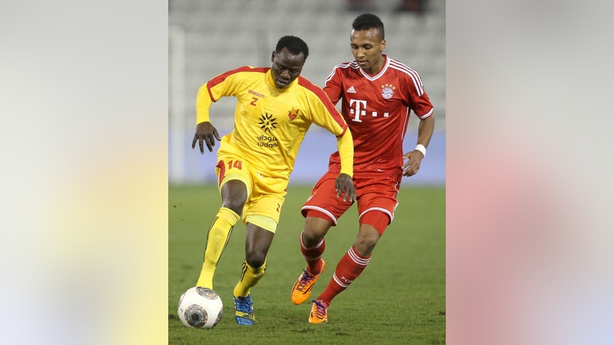 FILE - In this Jan. 9, 2014, file photo, Bayern Munich's Julian Green, right, of Munich, and Balla Jabir, of Al-Merrikh, challenge for the ball, during their friendly soccer match, at Al-Saad stadium in Doha. Green has joined the U.S. soccer team, a glistening talent still developing, a youngster who grew up in Germany with regular trips to see his father in Florida. He will make his debut for the United States against Mexico on Wednesday, April 2. (AP Photo/Osama Faisal, File)