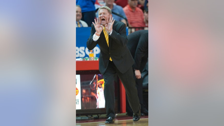 Virginia Military Institute's  head coach Duggar Baucom yells to his players against Yale during the first half of an NCAA CIT semi-final college basketball game at Cameron Hall, Tuesday, April 1, 2014, in Lexington, Va. (AP Photo/Don Petersen)