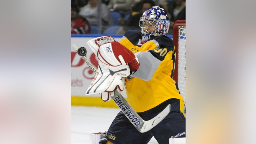 Buffalo Sabres goaltender Nathan Lieuwen, of the Czech Republic, makes a save against the New Jersey Devils during the second period of an NHL hockey game in Buffalo, N.Y., Tuesday, April 1 2014. (AP Photo/Gary Wiepert)