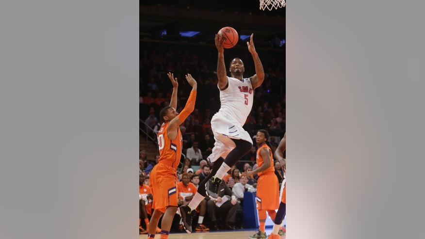 SMU's Markus Kennedy (5) drives past Clemson's Jordan Roper (20) during the first half of an NCAA college basketball game in the semifinals of the NIT Tuesday, April 1, 2014, in New York. (AP Photo/Frank Franklin II)