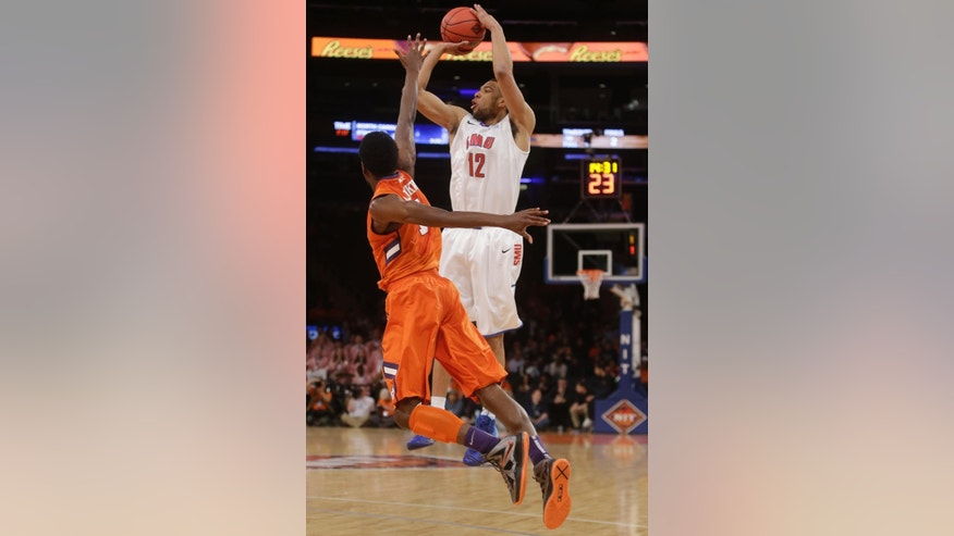 SMU's Nick Russell (12) shoots over Clemson's Austin Ajukwa (1) during the first half of an NCAA college basketball game in the semifinals of the NIT Tuesday, April 1, 2014, in New York. (AP Photo/Frank Franklin II)