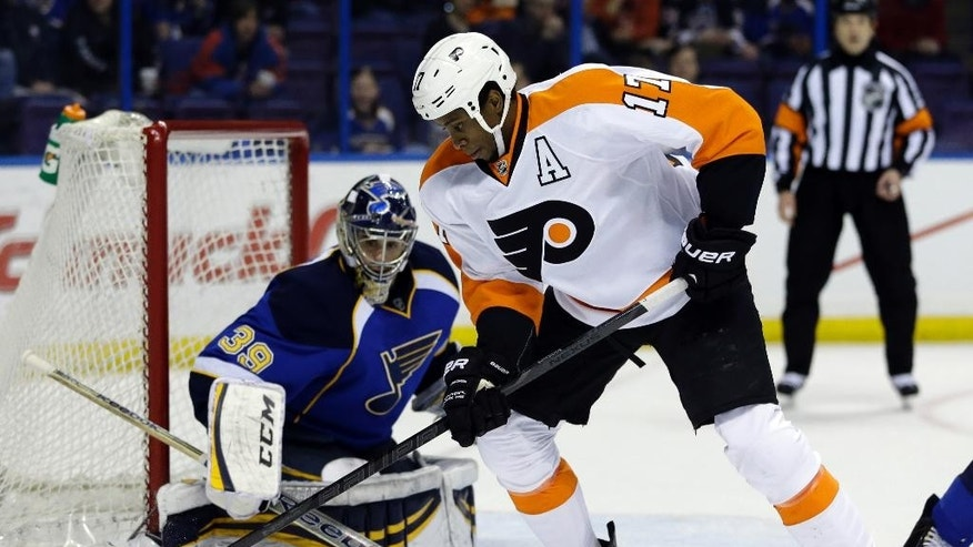 Philadelphia Flyers' Wayne Simmonds (17) controls the puck as St. Louis Blues goalie Ryan Miller watches during the first period of an NHL hockey game Tuesday, April 1, 2014, in St. Louis. (AP Photo/Jeff Roberson)