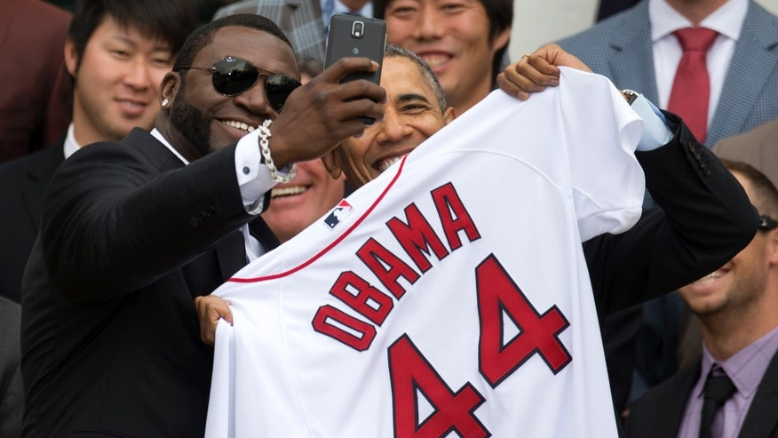 Boston Red Sox player David 'Big Papi' Ortiz takes a selfie with President Barack Obama Tuesday, April 1, 2014.