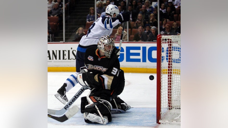 Winnipeg Jets defenseman Jacob Trouba (8) scores against Anaheim Ducks goalie Frederik Andersen (31), of Denmark in the first period of an NHL hockey game Monday, March 31, 2014, in Anaheim, Calif. (AP Photo/Alex Gallardo)