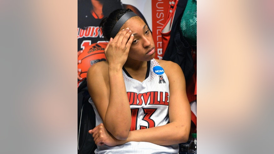 Louisville's Cortnee Walton pauses in the locker room following the regional final against Maryland in the NCAA women's college basketball tournament, Tuesday, April 1, 2014, in Louisville, Ky. Maryland defeated Louisville 76-73.  (AP Photo/Timothy D. Easley)