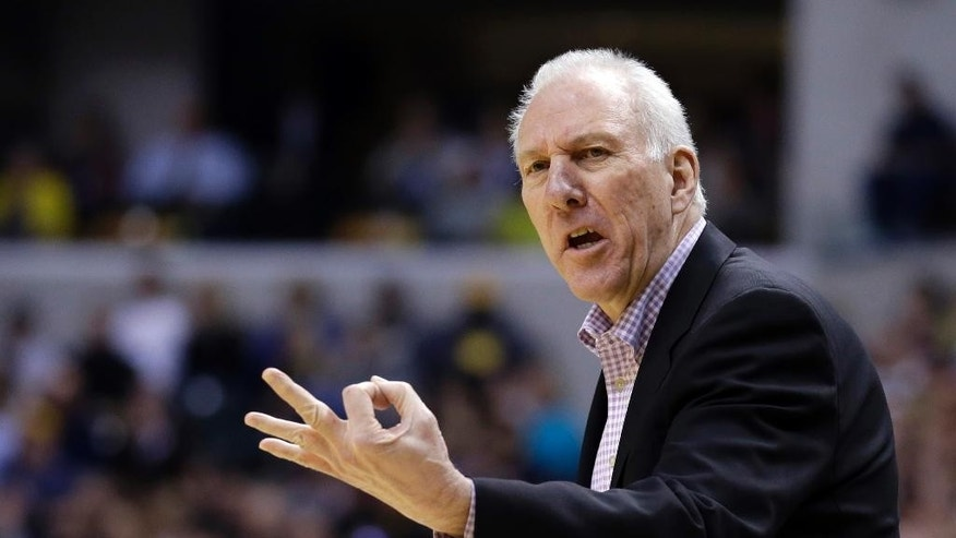 San Antonio Spurs head coach Gregg Popovich looks for a three second call in the first half of an NBA basketball game against the Indiana Pacers in Indianapolis, Monday, March 31, 2014.  (AP Photo/Michael Conroy)