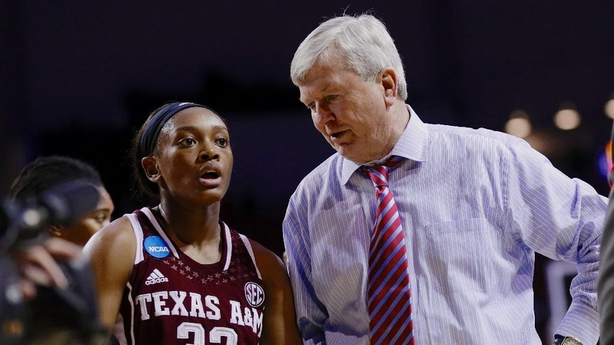 Texas A&M coach Gary Blair talks to Courtney Walker (33) at the end of the first half of a regional final game against Connecticut in the NCAA college basketball tournament in Lincoln, Neb., Monday, March 31, 2014. (AP Photo/Nati Harnik)