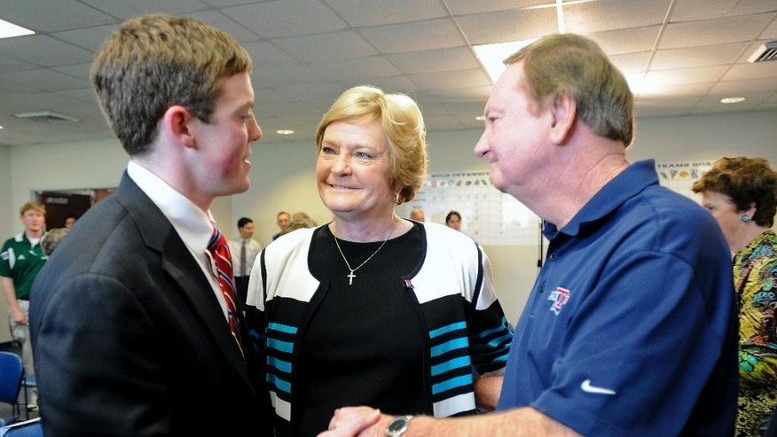 Tyler Summitt, left, his mother, Hall-of-Fame Tennessee Lady Vols coach Pat Summitt, and former Louisiana Tech coach Leon Barmore share a moment after a press conference Wednesday, April 2, 2014 to announce Tyler Summitt, 23, as the new women's basketball coach at the college, in Ruston, La. (AP Photo/The Shreveport Times, Douglas Collier) MAGS OUT; MANDATORY CREDIT SHREVEPORTTIMES.COM;  NO SALES