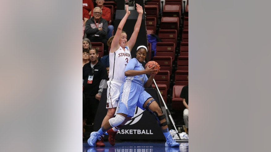 North Carolina forward Stephanie Mavunga, right, drives against Stanford forward Mikaela Ruef during the first half of a regional final of the NCAA women's college basketball tournament in Stanford, Calif., Tuesday, April 1, 2014. (AP Photo/Jeff Chiu)