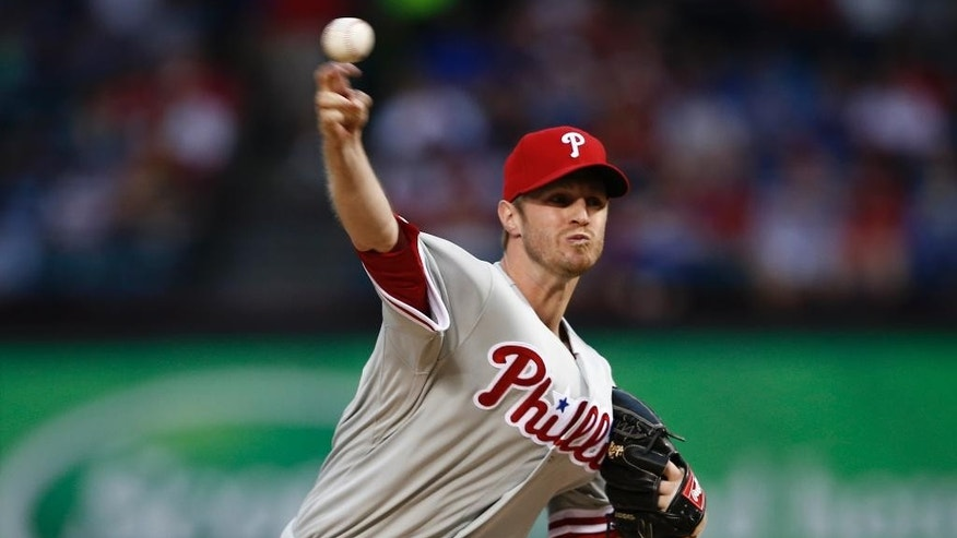 Philadelphia Phillies startng pitcheri Kyle Kendrick delivers to the Texas Rangers during the first inning of a baseball game on Wednesday, April 2, 2014, in Arlington, Texas. (AP Photo/Jim Cowsert)
