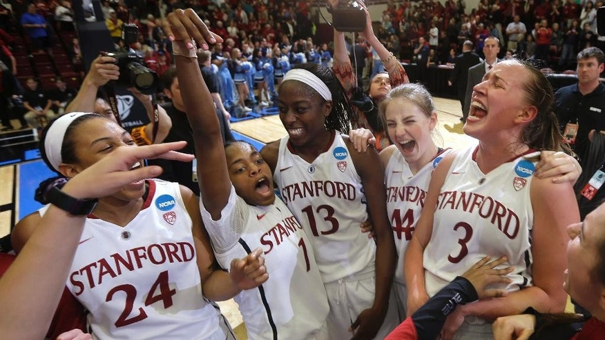 Stanford forward Erica McCall (24), guard Lili Thompson (1), forward Chiney Ogwumike (13), guard Karlie Samuelson (44) and forward Mikaela Ruef (3) celebrate after Stanford defeated North Carolina in a regional final at the NCAA women's college basketball tournament in Stanford, Calif., Tuesday, April 1, 2014. Stanford won 74-65. (AP Photo/Marcio Jose Sanchez)