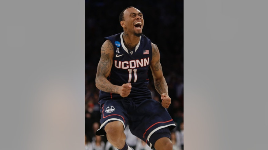 Connecticut's Ryan Boatright (11) celebrates during the second half of a regional final against Michigan State in the NCAA college basketball tournament  Sunday, March 30, 2014, in New York. Connecticut won the game 60-54. (AP Photo/Frank Franklin II)