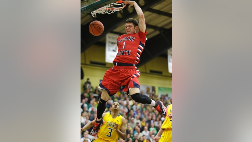 Fresno State's Tyler Johnson (1) dunks in front of Siena's Ryan Oliver (3) during the first half of a College Basketball Invitational championship series game Wednesday, April 2, 2014, in Loudonville, N.Y. (AP Photo/Mike Groll)