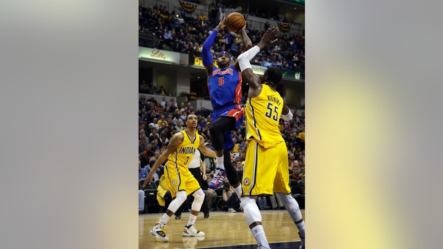 Detroit Pistons forward Josh Smith (6) shoots between Indiana Pacers defenders George Hill (3) and Roy Hibbert (55) during the first half of an NBA basketball game in Indianapolis, Wednesday, April 2, 2014. (AP Photo/AJ Mast)