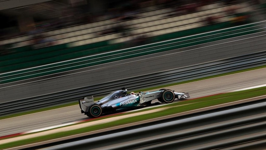 Mercedes driver Lewis Hamilton of Britain steers his car during the Malaysian Formula One Grand Prix at Sepang International Circuit in Sepang, Malaysia, Sunday, March 30, 2014. Hamilton won the race. (AP Photo/Lai Seng Sin)