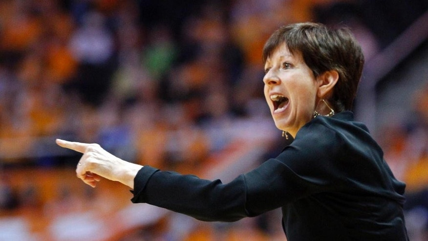 FILE - In this Jan. 20, 2014 file photo, Notre Dame head coach Muffet McGraw yells to her team in the second half of an NCAA college basketball game against Tennessee, in Knoxville, Tenn. Notre Dame and Connecticut are on an unprecedented collision course to meet in the national championship game. First, the two unbeaten teams will have to win their national semifinal games before the historic matchup can take place. (AP Photo/Wade Payne, File)