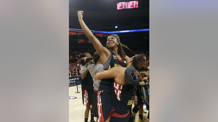 Maryland guard Sequoia Austin celebrates after Maryland defeated Louisville 76-73 in a regional final of the NCAA women's college basketball tournament Tuesday, April 1, 2014, in Louisville, Ky. (AP Photo/John Bazemore)