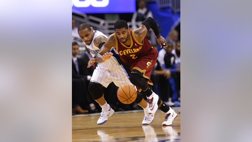 Cleveland Cavaliers' Kyrie Irving (2) goes after a loose ball in front of Orlando Magic's Jameer Nelson, left, during the first half of an NBA basketball game in Orlando, Fla., Wednesday, April 2, 2014. (AP Photo/John Raoux)