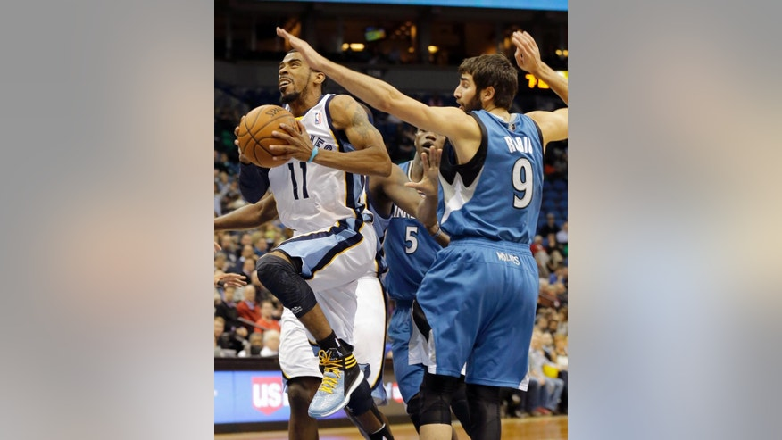 Memphis Grizzlies guard Mike Conley (11) goes to the basket against Minnesota Timberwolves guard Ricky Rubio (9), of Spain, during the first quarter of an NBA basketball game in Minneapolis, Wednesday, April 2, 2014. (AP Photo/Ann Heisenfelt)