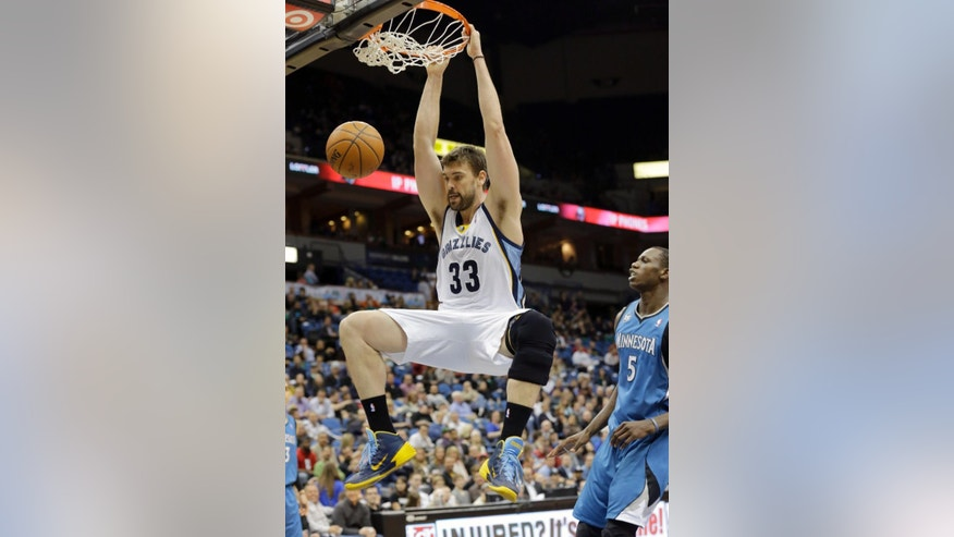 Memphis Grizzlies center Marc Gasol (33), of Spain, dunks in front of Minnesota Timberwolves center Gorgui Dieng (5) during the second quarter of an NBA basketball game in Minneapolis, Wednesday, April 2, 2014. (AP Photo/Ann Heisenfelt)