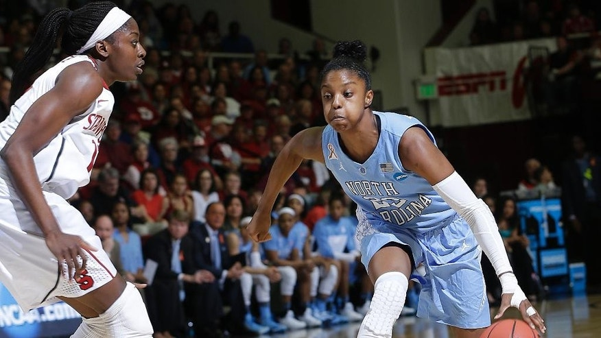 North Carolina guard Diamond DeShields (23) drives against Stanford forward Chiney Ogwumike during the first half of a regional final of the NCAA women's college basketball tournament in Stanford, Calif., Tuesday, April 1, 2014. (AP Photo/Marcio Jose Sanchez)