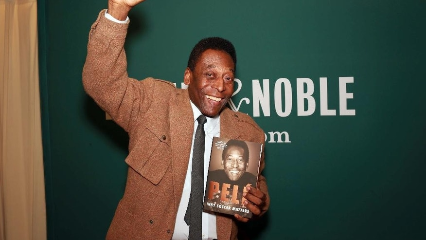 """Brazilian soccer star Pele makes an appearance at Barnes & Noble to signs copies of his book """"Why Soccer Matters"""" on Tuesday, April 1, 2014, in New York. (Photo by Luiz Ribeiro/Invision/AP)"""