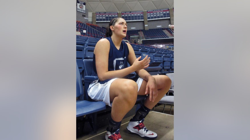 Connecticut forward Stefanie Dolson answers a reporter's question Thursday, April 3, 2012 in Storrs, Conn., following the team's final practice before boarding a flight to the Women's NCAA Final Four in Nashville. (AP Photo/Pat Eaton-Robb)
