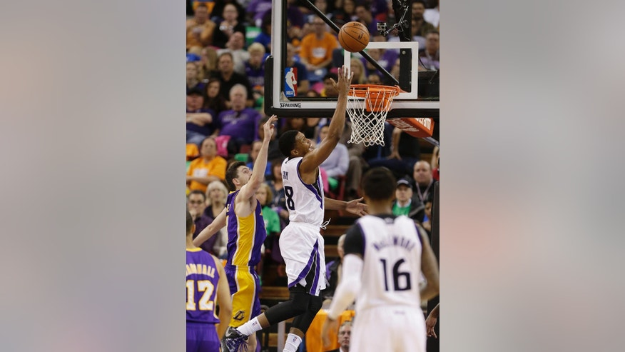 Sacramento Kings forward Rudy Gay, center, goes to the basket past Los Angeles Lakers forward Ryan Kelly, second from left, during the first quarter of an NBA basketball game Wednesday, April 2, 2014, in Sacramento, Calif. (AP Photo/Rich Pedroncelli)
