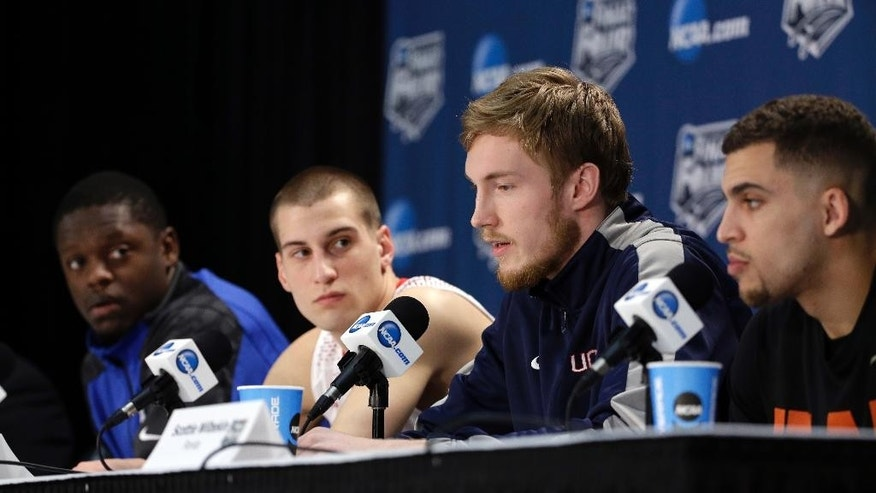 Kentucky's Julius Randle, left to right, Wisconsin's Ben Brust, Connecticut's Niels Giffey and Florida's Scottie Wilbekin participate in a news conference for their NCAA Final Four tournament college basketball semifinal games Thursday, April 3, 2014, in Dallas. (AP Photo/David J. Phillip)