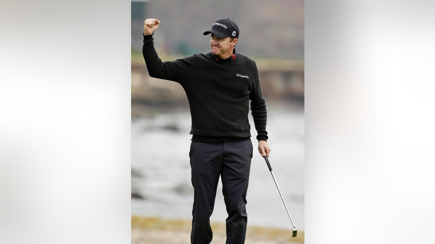 ADVANCE FOR WEEKEND EDITIONS, APRIL 5-6 - FILE - In this Feb. 9, 2014, file photo, Jimmy Walker reacts on the 18th green of the Pebble Beach Golf Links after winning the AT&T Pebble Beach Pro-Am golf tournament in Pebble Beach, Calif. The rookie class at Augusta National might be the strongest ever for the Masters, from Jordan Spieth and Patrick Reed to Victor Dubuisson and Walker.  (AP Photo/Eric Risberg, File)