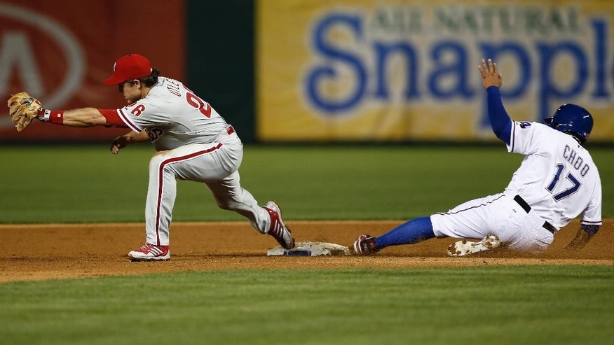 Philadelphia Phillies second baseman Chase Utley (26) stretches to force out Texas Rangers' Shin-Soo Choo (17) on a ball hit by Rangers' Elvis Andrus during the sixth inning of a baseball game, Wednesday, April 2, 2014, in Arlington, Texas. Andrus was safe at first. (AP Photo/Jim Cowsert)