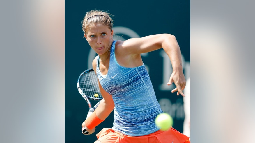 Sara Errani, of Italy, returns to Peng Shuai, of China, during the Family Circle Cup tennis tournament in Charleston, S.C., Thursday, April 3, 2014. (AP Photo/Mic Smith)