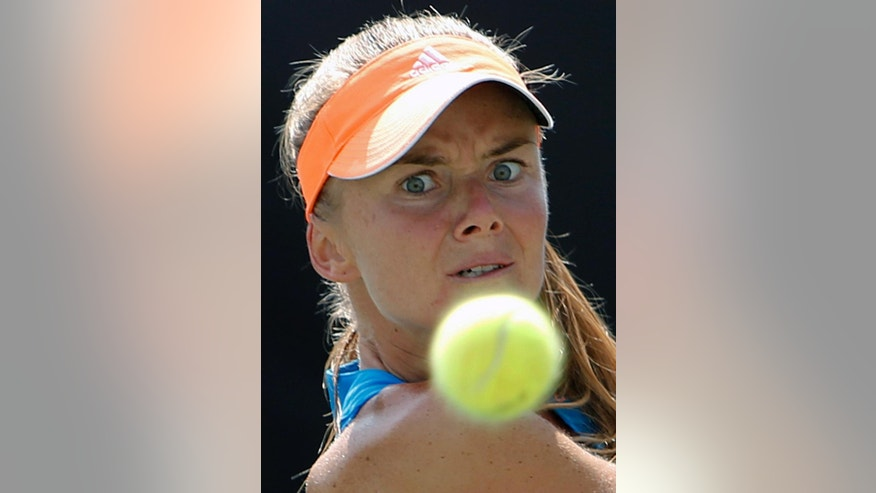 Daniela Hantuchova, of Slovakia, returns to Teliana Pereira, of Brazil, during a match at the Family Circle Cup tennis tournament in Charleston, S.C., Thursday, April 3, 2014. (AP Photo/Mic Smith)