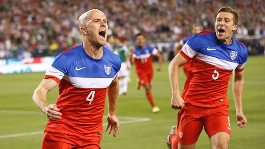 U.S. midfielder Michael Bradley, left, celebrates with defender Matt Besler (5) after scoring a goal against Mexico during the first half of an international friendly soccer match, Wednesday, April 2, 2014, in Glendale, Ariz. (AP Photo/The Arizona Republic, Michael Chow) MESA OUT  MARICOPA COUNTY OUT  MAGS OUT  NO SALES