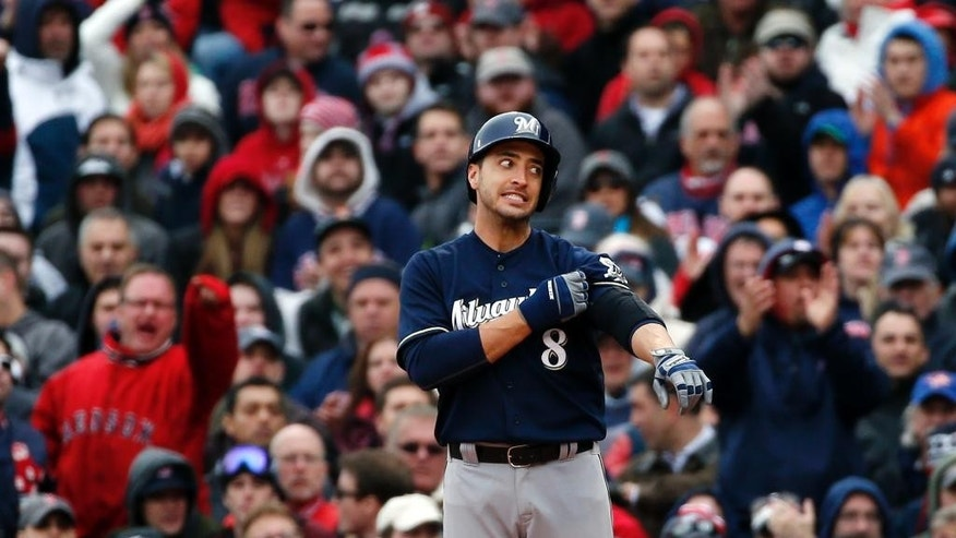 Milwaukee Brewers' Ryan Braun (8) pauses at first base after grounding out in the seventh inning of a baseball game against the Boston Red Sox at Fenway Park in Boston, Friday, April 4, 2014. (AP Photo/Elise Amendola)