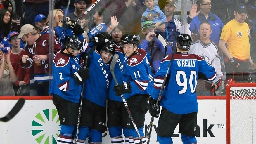 Colorado Avalanche defenseman Andre Benoit, second from left, is congratulated by teammates Nick Holden (2), John Mitchell, center, Jamie McGinn (11) and Ryan O'Reilly (90) after scoring a goal against the New York Rangers during the second period of an NHL hockey game on Thursday, April 3, 2014, in Denver. (AP Photo/Jack Dempsey)