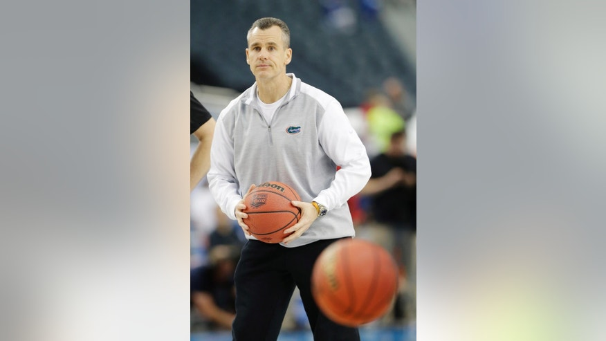 Florida head coach Billy Donovan runs a drill during practice for their NCAA Final Four tournament college basketball semifinal game Friday, April 4, 2014, in Dallas. Florida plays Connecticut on Saturday, April 5, 2014. (AP Photo/Eric Gay)