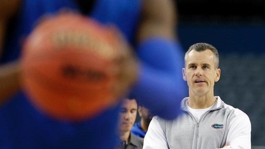 Florida head coach Billy Donovan watches a drill during practice for an NCAA Final Four tournament college basketball semifinal game Friday, April 4, 2014, in Dallas. Florida plays Connecticut on Saturday, April 5, 2014. (AP Photo/David J. Phillip)