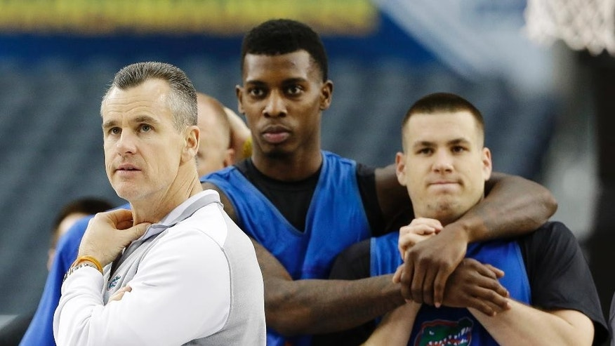 From left, Florida head coach Billy Donovan, forward Chris Walker, and guard Billy Donovan watch a drill during practice for their NCAA Final Four tournament college basketball semifinal game Friday, April 4, 2014, in Dallas. Florida plays Connecticut on Saturday, April 5, 2014. (AP Photo/David J. Phillip)